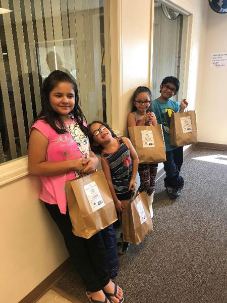 Along with Nevaeh Valdez, Josiah, Heavenly and Isaac Oliva received Power-Up Kidz Sacks